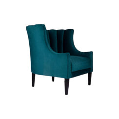 Georg Upholstered Blue Velvet Armchair with Round Back and Black Legs Beside View